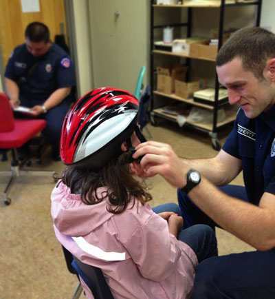 NKF&R staff fit third graders' helmets today at Suquamish Elementary