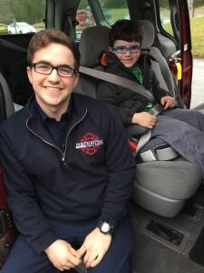 Gordon Elementary Student with Firefighter in Van